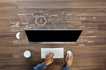 Foto de Creative thinking drawing business success strategy plan ideas on wooden table background, Inspiration concept with businessman working on computer, View from above - Imagen libre de derechos