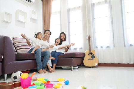Photo for Happy asian family in living room at home, togetherness relaxation concept - Royalty Free Image