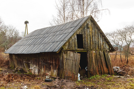 Photo for standing at the edge of the road, an old wooden house - Royalty Free Image