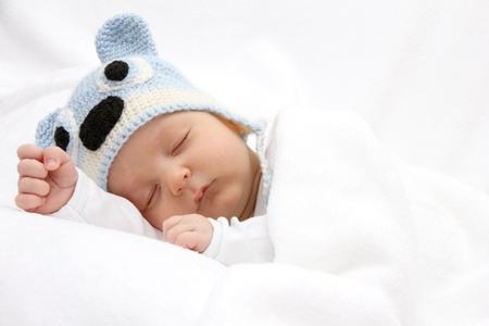 Photo for Sleeping baby with knitted hat - Royalty Free Image