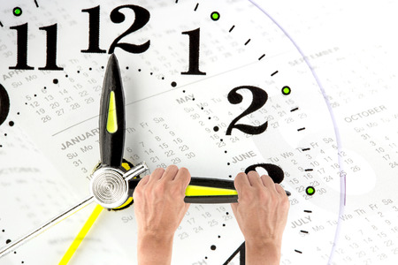 Photo pour Deadline. hand trying to stop time. Time Management. Time pressure. Cure for old age. Annual reports. Front view. - image libre de droit