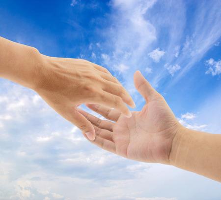 Foto de helping hands on sky background - Imagen libre de derechos
