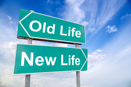 Foto de New life old life road sign on sky background, business concept - Imagen libre de derechos