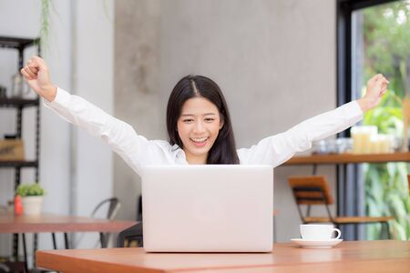 Foto de Asian young businesswoman excited and glad of success with laptop, career freelance business concept. - Imagen libre de derechos
