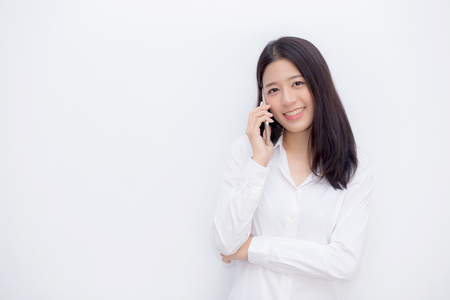 Photo pour Beautiful young asian woman talking mobile phone and smile standing on cement background, freelancer female calling telephone, communication concept. - image libre de droit