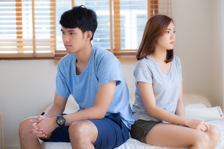 Photo pour Relationship of young asian couple having problem on bed in the bedroom at home, family having conflict argument with unhappy, man and woman with issue, failure and stress together. - image libre de droit