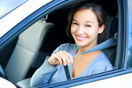 Photo for Always fasten your seatbelt. Girl in a car - Royalty Free Image