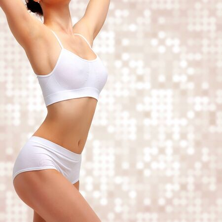 Photo for Slim slender woman in white underwear posing against abstract background. Wellness and body care concept. Healthy lifestyle - Royalty Free Image