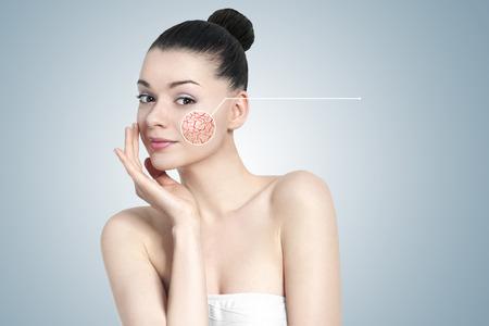 Photo pour Beautiful young brunette woman portrait - skin care concept - image libre de droit