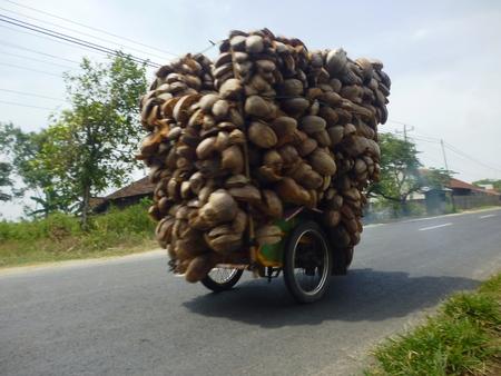 Photo pour a motorist carry its load overload  - image libre de droit
