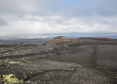 Epic view with hiking trail in Kverkfjoll: red volcanic stone mountain and melting glacier on the background remote part of the central highlands of Iceland, Vatnajokull National Park, Europe