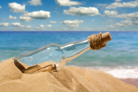 Foto de Message in a bottle on the beach - Imagen libre de derechos