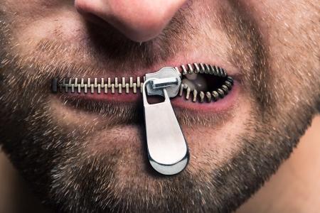 Foto de Insubordinate man with zipped mouth - Imagen libre de derechos