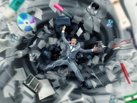 Scared businessman is falling into office chaos