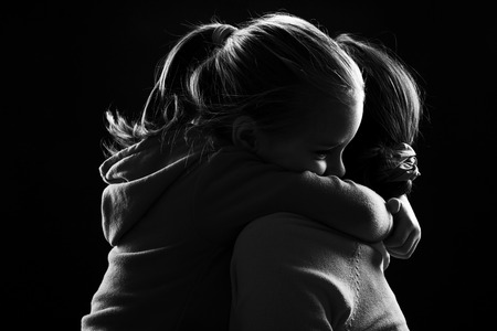 Photo for Black and white image of a little girl hugging her mother - Royalty Free Image