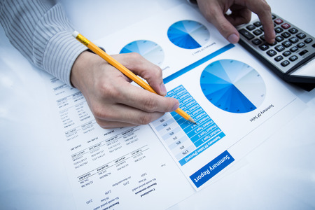 Foto de man hand with pen and business report. Accounting - Imagen libre de derechos