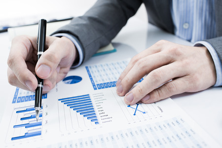 Photo pour Businessman analyzing investment charts. Accounting - image libre de droit