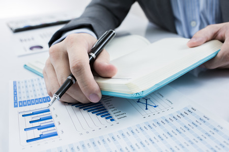 Foto de Businessman analyzing investment charts. Accounting - Imagen libre de derechos