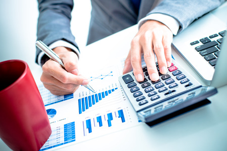 Photo pour Businessman analyzing investment charts with laptop. Accounting - image libre de droit