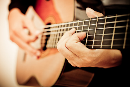 Photo for Practicing in playing guitar. Handsome young men playing guitar - Royalty Free Image