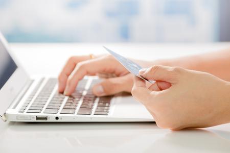 Photo pour Woman Hands holding credit card and using laptop. Online shopping - image libre de droit