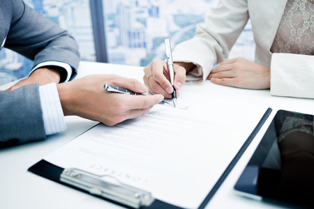 Photo for Female hand signing contract. - Royalty Free Image
