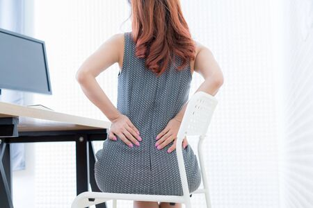 Foto de Business woman with back pain. Office syndrome - Imagen libre de derechos