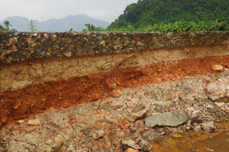 Photo for The curb erosion from storms To indicate the layers of soil and rock  - Royalty Free Image