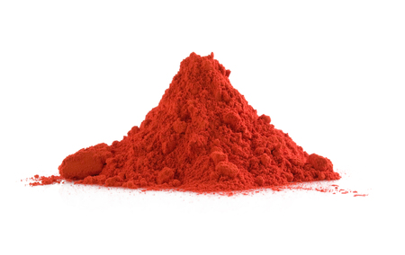 Photo pour Pile of red powder isolated on white - image libre de droit