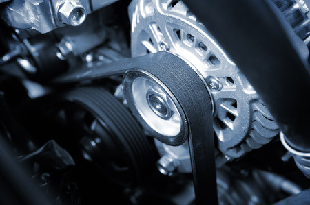 Photo pour closeup car timing belt in clean engine room - image libre de droit