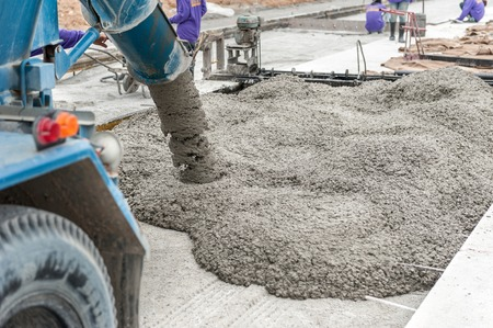 Photo pour mixed concrete pouring at construction site - image libre de droit