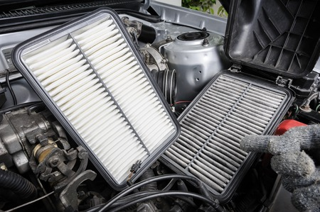 Photo pour comparison between new and used air filter for car, automotive spare part - image libre de droit