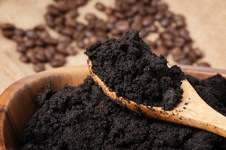 Photo for closeup detail of coffee ground in wooden bowl - Royalty Free Image