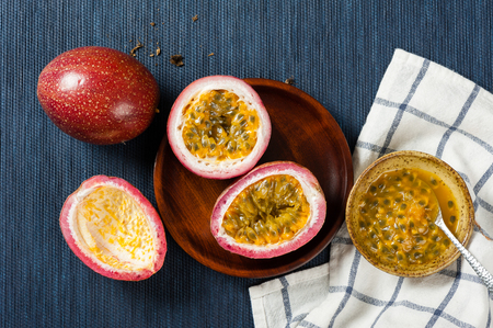 Photo pour Fresh passion fruit on the desk. Passion fruit contains many small black seeds covered with the fruit's flesh. - image libre de droit