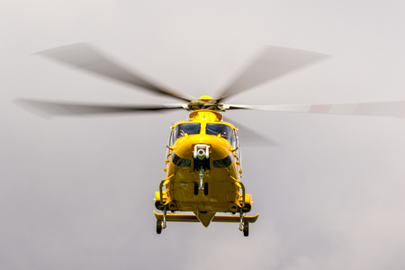 Photo for The East Midlands Air Ambulance airlifting a patient to the nearest hospital. - Royalty Free Image