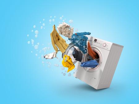 Foto de Washing machine and flying clothes on blue background - Imagen libre de derechos