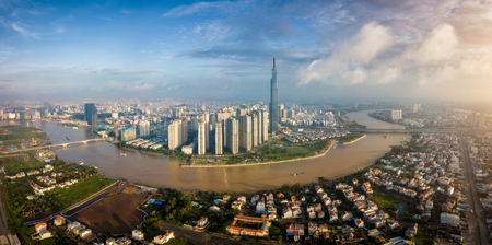 Foto de Aerial view of Ho Chi Minh City skyline and skyscrapers in center of heart business at Ho Chi Minh City downtown. Panorama of cityscape on Saigon river in Ho Chi Minh City at Vietnam at sunrise scene - Imagen libre de derechos