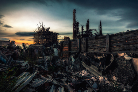 Photo pour The world after nuclear war.Destroyed by the war remains of buildings at sunset - image libre de droit