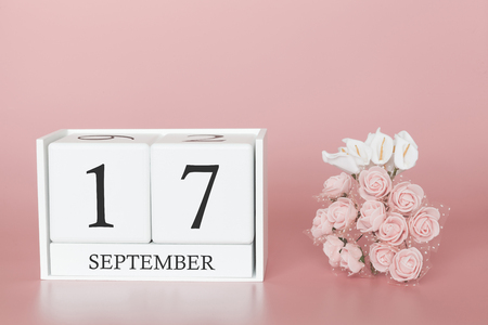 Foto de September 17th. Day 17 of month. Calendar cube on modern pink background, concept of bussines and an importent event. - Imagen libre de derechos