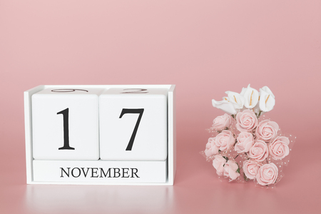 Foto de November 17th. Day 17 of month. Calendar cube on modern pink background, concept of bussines and an importent event. - Imagen libre de derechos