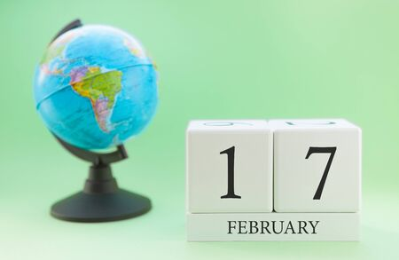 Foto de Planner wooden cube with numbers, 17 day of the month of February, winter - Imagen libre de derechos