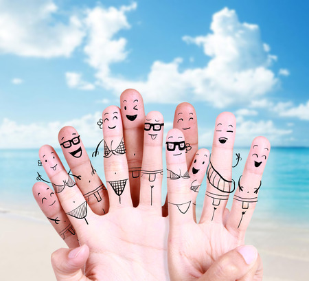 Foto de group of happy young people at the beach with drawing finger symbol - Imagen libre de derechos