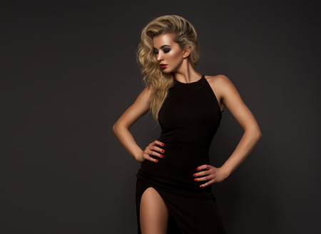 Foto de Cute blonde woman in a gorgeous dress - Imagen libre de derechos