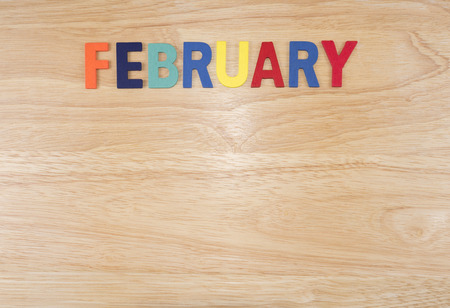 Foto de Word spelling month in the year February by wooden letters on wood background (Month name word series) - Imagen libre de derechos