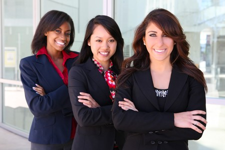 A pretty diverse young business woman team at office building