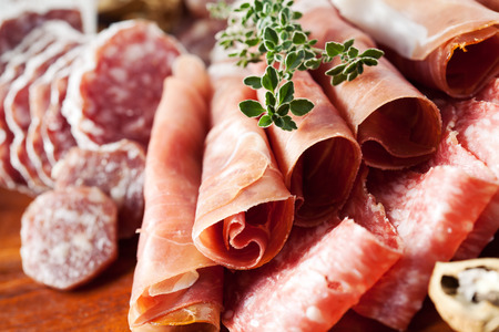 Photo for Cold cuts: charcuterie assortment on wooden board - Royalty Free Image