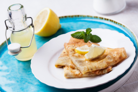 Photo for English-style pancakes with lemon and sugar, traditional for Shrove Tuesday  - Royalty Free Image