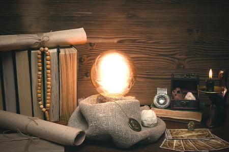 Foto de Crystal ball and tarot cards on fortune teller desk. Future reading concept. Paranormal magic table. - Imagen libre de derechos
