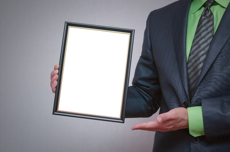 Foto für Blank diploma or certificate mock up in businessman hand. Empty photo frame border with copy space. - Lizenzfreies Bild
