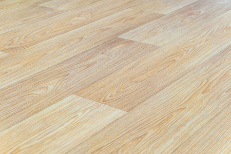 Photo pour Linoleum flooring with embossed light wood texture close-up. Horizontal layout perspective. Limited depth of field. - image libre de droit